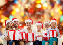 Happy family in santa helper hats with gift boxes Royalty Free Stock Photography