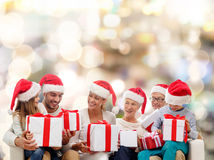 Happy family in santa helper hats with gift boxes Royalty Free Stock Image
