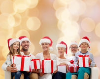 Happy family in santa helper hats with gift boxes Royalty Free Stock Photos