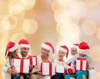 Happy family in santa helper hats with gift boxes Royalty Free Stock Photo