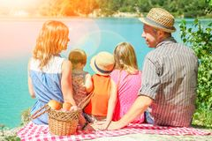 Happy family by the sea on nature picnic royalty free stock images