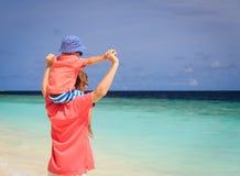 Happy family on sea vacation Stock Photos