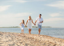 Happy family at the seaside Royalty Free Stock Photos