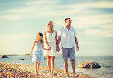 Happy family at the seaside Stock Photo