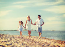 Happy family at the seaside Stock Image