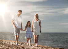 Happy family at the seaside Stock Photos