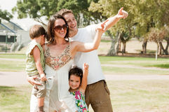Happy family see Something. In the park royalty free stock photos
