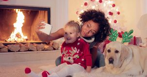 Happy family selfie portrait at Christmas stock video