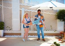 Happy family setting up a trellis for plants on patio Stock Photo