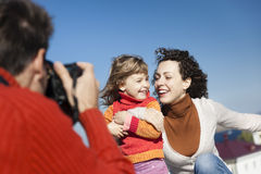Happy family shooting Stock Photography