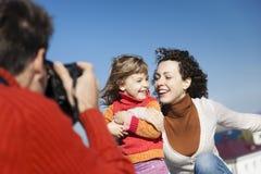 Happy family shooting Stock Photography