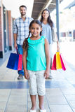 Happy family with shopping bags Royalty Free Stock Images