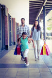 Happy family with shopping bags Royalty Free Stock Photography
