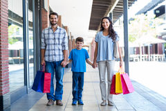 Happy family with shopping bags Royalty Free Stock Photo