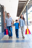 Happy family with shopping bags Stock Photos