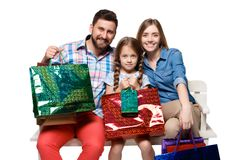 Happy family with shopping bags sitting at studio Stock Image