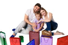 Happy family with shopping bags sitting at studio Royalty Free Stock Images