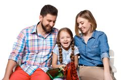 Happy family with shopping bags sitting at studio Royalty Free Stock Photography
