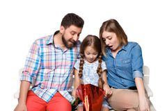 Happy family with shopping bags sitting at studio Royalty Free Stock Photo