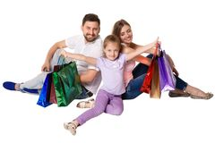 Happy family with shopping bags sitting at studio Stock Photos