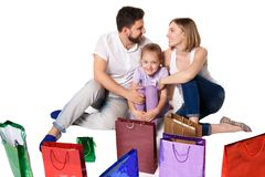 Happy family with shopping bags sitting at studio Stock Photography