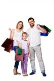 Happy family with shopping bags standing at studio Royalty Free Stock Photo