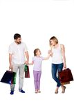 Happy family with shopping bags standing at studio Stock Image