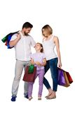 Happy family with shopping bags standing at studio Stock Images