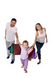 Happy family with shopping bags standing at studio Stock Photography
