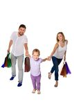 Happy family with shopping bags standing at studio Royalty Free Stock Images