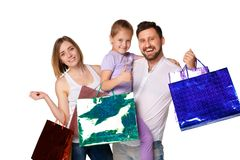 Happy family with shopping bags standing at studio Stock Photo