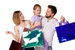 Happy family with shopping bags standing at studio Royalty Free Stock Photos