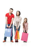 Happy family with shopping bags Stock Images
