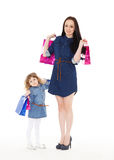 Happy family with shopping bags. Stock Image