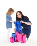 Happy family with shopping bags. Stock Photos