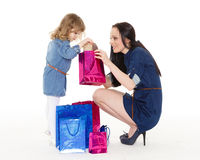 Happy family with shopping bags. Stock Images