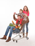 Happy family with a shopping cart in supermarket Royalty Free Stock Photography