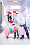 Happy family shopping for christmas Stock Images