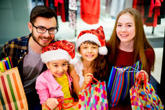 Happy family shopping. A happy family is shopping for christmas gifts royalty free stock images