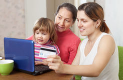 Happy family shopping in internet from home Stock Photo