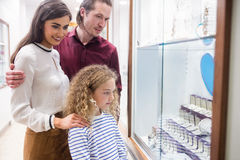 Happy family shopping in jeweler shop Royalty Free Stock Photo