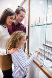 Happy family shopping in jeweler shop Royalty Free Stock Images