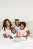 Happy family shopping online with laptop Royalty Free Stock Photography