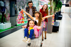 Happy family shopping. A happy family is shopping together in a mall royalty free stock image