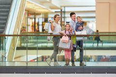 Happy family shopping. At the weekend in the shopping center royalty free stock image