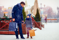 Happy family on shopping in winter city Stock Photo