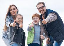 Happy family showing thumbs up royalty free stock photos