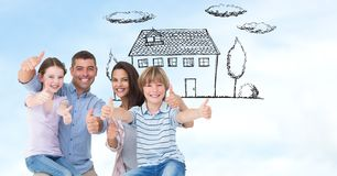 Happy family showing thumbs up sign with house in background Stock Image