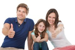 Happy family showing thumbs up together Stock Photo