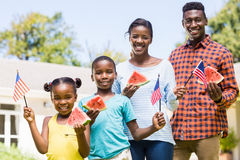 Happy family showing usa flag and eating watermelon Royalty Free Stock Photos